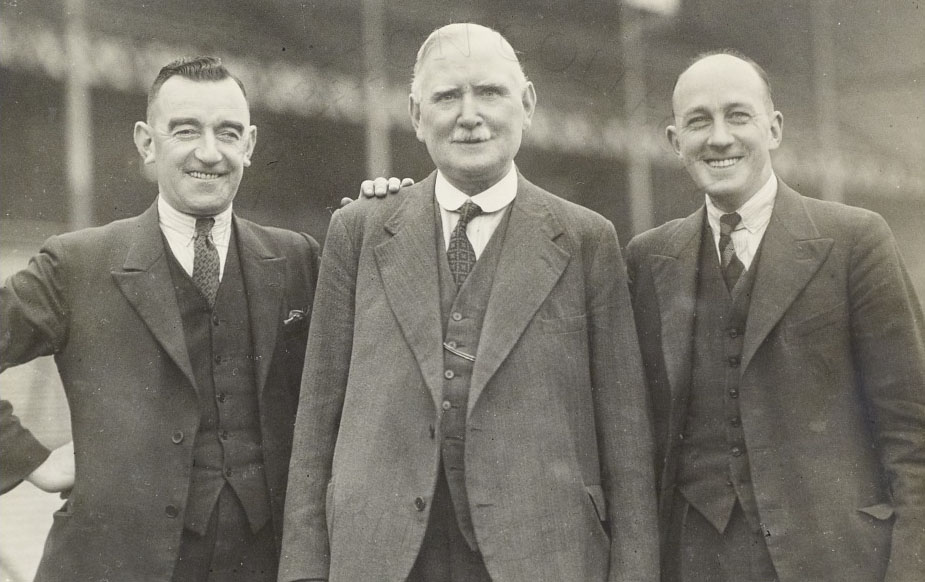 Hunter Hart and Theo Kelly with a director, mid-1930s