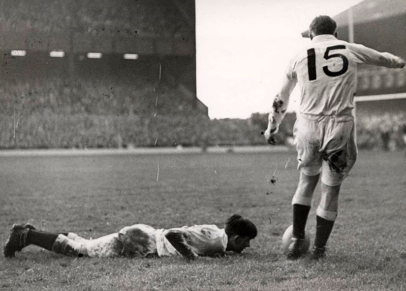 Dick Uren kicks to convert for England in 1950