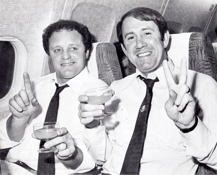 Mick Heaton and Howard Kendall toast victory on the plane home from Rotterdam
