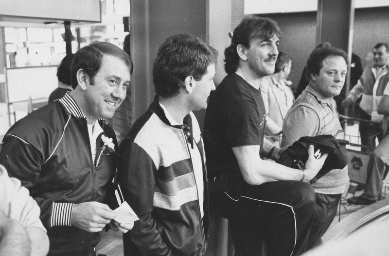 Heaton, Kendall, Harvey and Southall await their luggage at the airport carousel