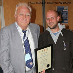 Matt Woods receiving his Stockport County appearance certificate in 2010